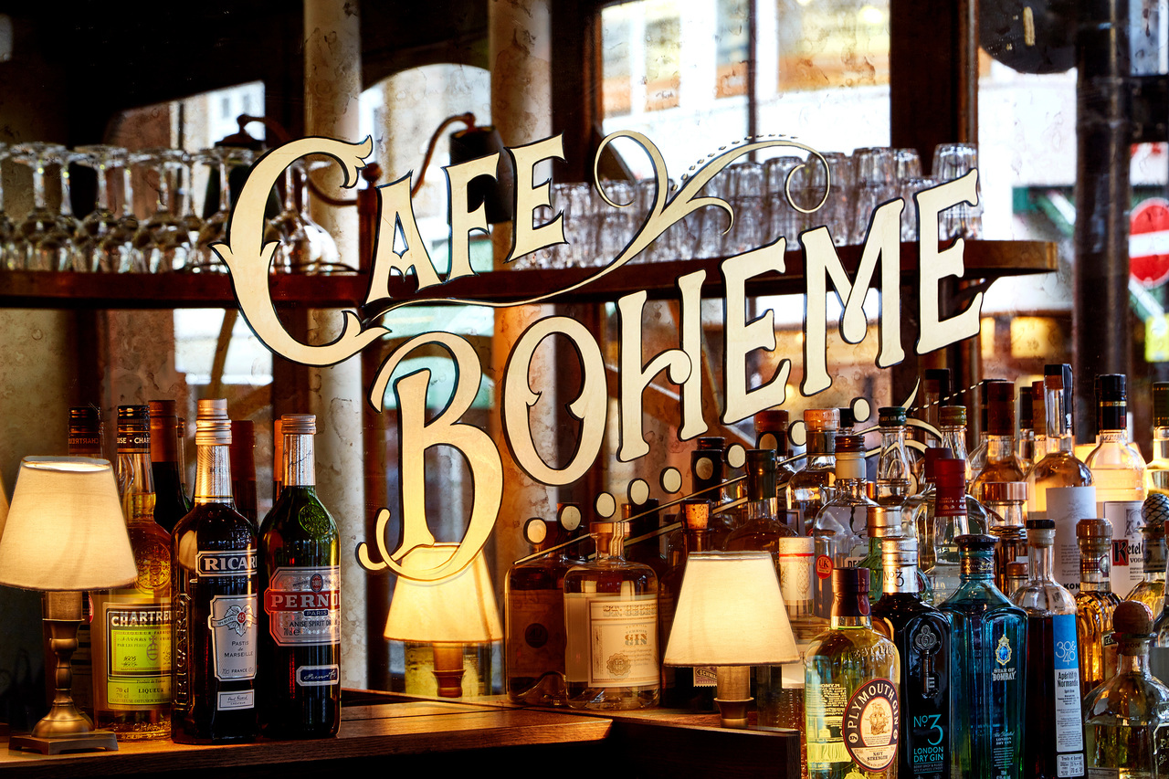 A mirror with 'Cafe Boheme' written on it