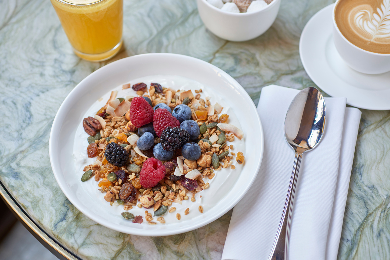 A bowl of granola, yoghurt and fruit