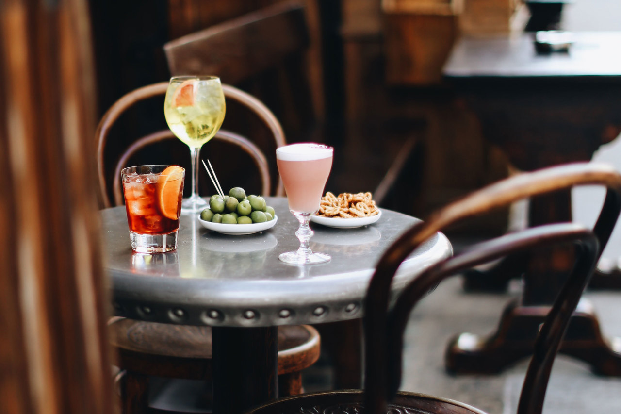 Cocktails and nibbles on an outside table